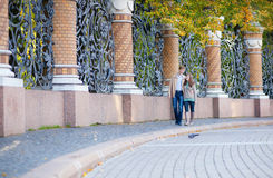 Couple walking by the grill of Mikhailovsky garden Royalty Free Stock Photo