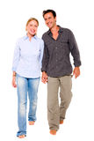 Couple walking hand in hand. On white background Stock Images