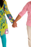 Couple walking hand in hand. Royalty Free Stock Photography