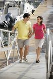 Couple walking at harbor stock photo