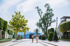 Couple walking by harbor , yacht on background royalty free stock images