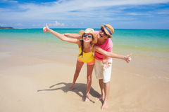 Couple walking and having fun on a tropical beach Stock Photo