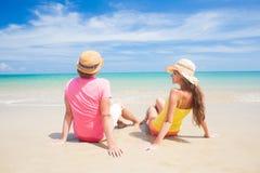 Couple walking and having fun on a tropical beach Stock Photos