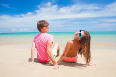 Couple walking and having fun on a tropical beach Royalty Free Stock Photo