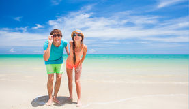 Couple walking and having fun on a tropical beach Stock Photography