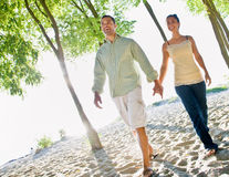 Couple walking holding hands at beach Royalty Free Stock Image