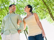 Couple walking holding hands at beach Royalty Free Stock Images
