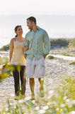 Couple walking holding hands at beach Royalty Free Stock Photo
