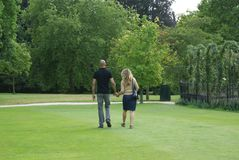 Couple walking holding hands in Blenheim Palace Rose Garden, England Royalty Free Stock Photos