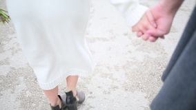 Couple walking holding hands close up.  stock video footage