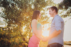 Couple walking holding hands Royalty Free Stock Photos