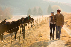 Couple walking horse farm Stock Photography