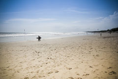 Couple walking kuta beach bali Royalty Free Stock Photo