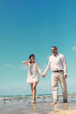 Couple walking and laughing Royalty Free Stock Image