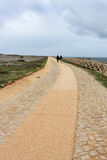 Couple walking on long path Stock Images