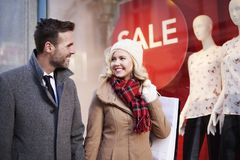 Christmas sales. Couple walking in the mall passage Stock Image