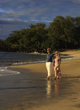 Couple walking on a maui beach Royalty Free Stock Photography