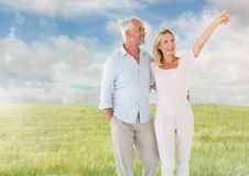 Couple walking in meadow nature Royalty Free Stock Images