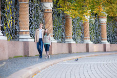 Couple walking in Mikhailovsky garden of Saint-Petersburg Royalty Free Stock Image