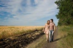 Couple walking on nature Royalty Free Stock Photos