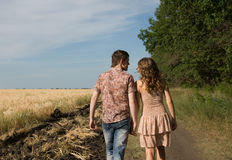 Couple walking on nature Royalty Free Stock Images