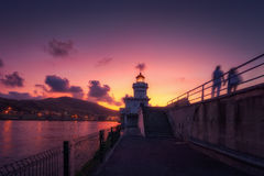 Couple walking near lighthouse in Getxo Stock Photography