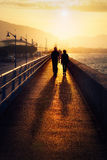 Couple walking near lighthouse in Getxo Royalty Free Stock Image