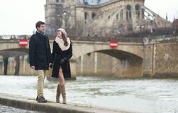 Couple walking near the Notre-Dame in Paris Stock Photo