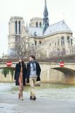 Couple walking near the Notre-Dame in Paris Royalty Free Stock Photography