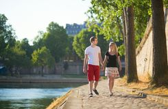 Couple walking near the Seine Stock Image