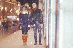 Couple walking in night city Stock Photography