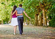 Couple walking outdoors Royalty Free Stock Photo