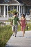 Couple walking outdoors. Stock Photos