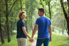 Couple walking outdoors and holding hands Stock Photo