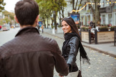Couple walking outdoors in old town Stock Images