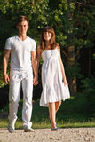Couple walking outdoors together Royalty Free Stock Photos
