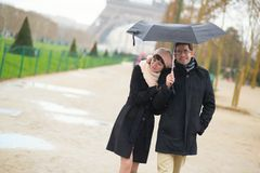 Couple in Paris under umbrella Royalty Free Stock Images