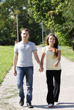 Couple walking in park Royalty Free Stock Image