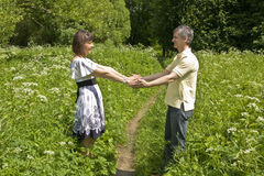 Couple walking in park Royalty Free Stock Images