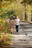 Couple walking in the park. Stock Image