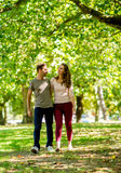 Couple walking at the park Stock Images