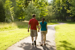 Couple Walking Through Park-Horizontal Stock Photo