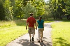 Couple Walking Through Park-Horizontal Stock Photo