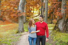Couple walking in the park stock photography