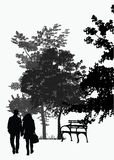 Couple walking in the park Stock Photos