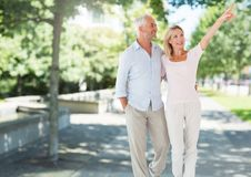 Couple walking in park street nature Royalty Free Stock Images