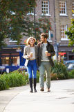 Couple Walking Through Park With Takeaway Coffee Royalty Free Stock Photography
