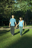 Couple Walking in the Park-Vertical Stock Images