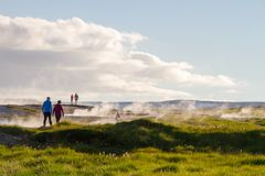 Couple walking past geothermal springs stock photography