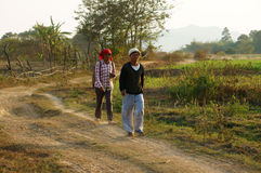 Couple walking on path at countryside Stock Images